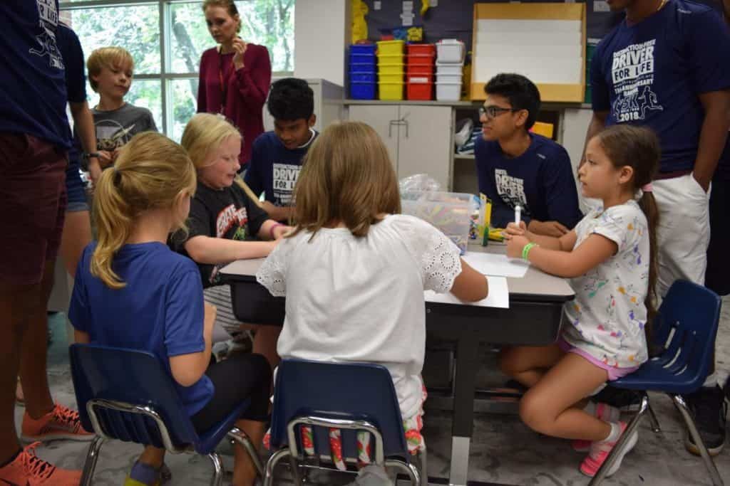 Distraction For Life Club Members leading kids in a game during our August 2019 session